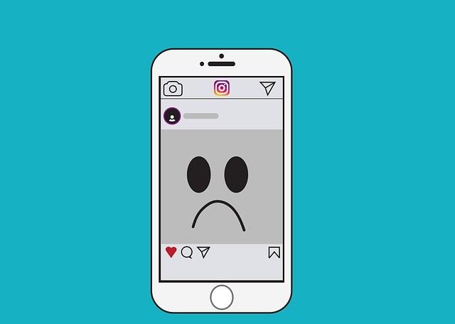Ilustração de um celular na tela do Instagram com uma foto com a carinha triste